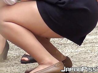 JAV hottie peeing herself up and being filmed by voyeur