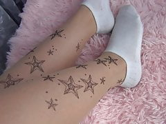 Pantyhose and white socks on the girl's sexy legs