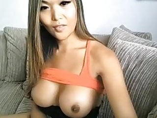 Asian shemale plays with her tits and tool