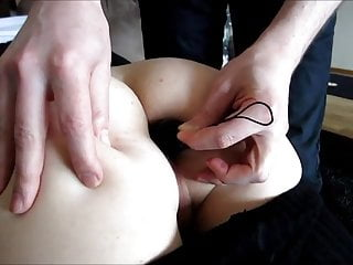 Slowly inserting a toy in his...