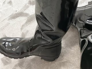 Guy in shiny pvc pants and gloss hunter boots