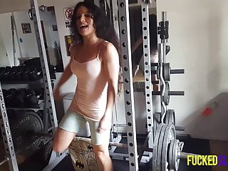 Sportive babe tia lifting weight home gym...