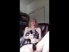 Hot milf with glasses masturbating till orgasm