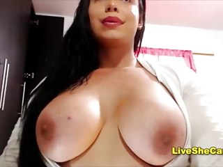 Voluptuous shemale shows big boobs...
