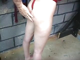 Young brunette is gagged, spanked and whipped in the basement by master