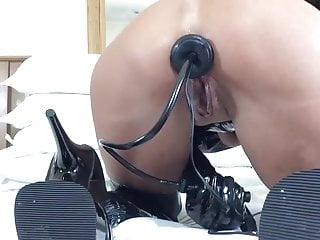 Plug toying in latex thighboots 2...