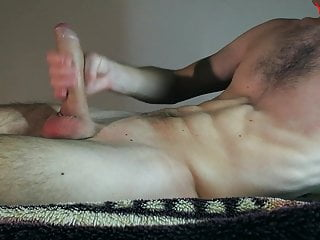 Sporty guy jerks off a big hard cock