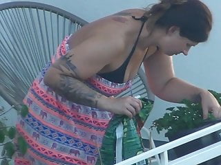 Spy BBW milf work at balcony and take off her clothes