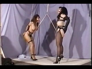 Two girls crotch roped together