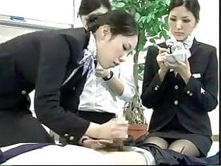Japanese Stewardess Demonstrates Proper CPR Procedures