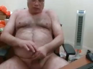 Webcam daddy jerks his load on his desk...