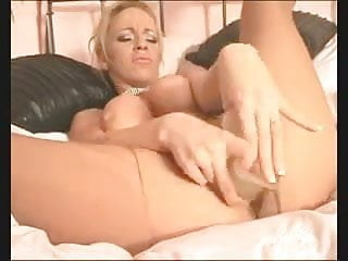 British slut Taylor plays with herself on the bed in tights