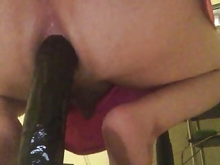 Big round bouncing on 14inch dildo...