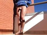 Tan pantyhose sunny balcony .