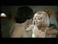 J. Collins in 1970 movie in white satin panty
