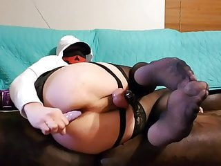 Crossdresser in chastity anal play.