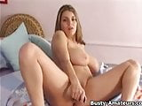 Busty Liana masturbates her pussy with dildo