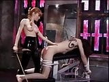 Misstress spanking her slaves ass