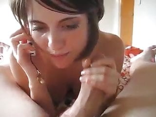 Brunette cock while she is on the phone...