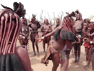 African himba women dance and swing their around...