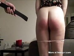 Female punished with a belt