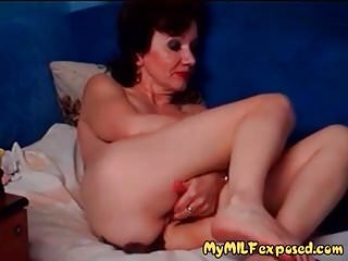 Exposed granny playing with stretched...