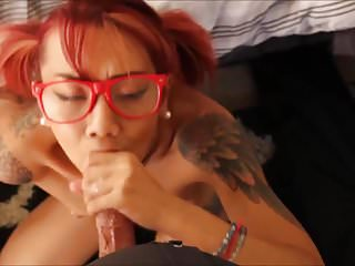 Pierced nipples inked asian deepthroating cock...