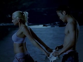 Chinese man and white girl on the beach...