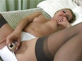 British slut Karen Wood plays with herself on the bed