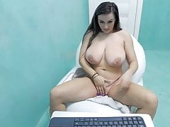 Girl with beautiful breasts caresses her pussy on camera
