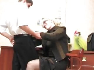 Mature lady boss and young employee