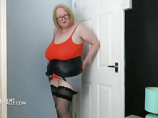Sally in and out of her tight pvc skirt