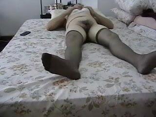 Masturbates her hairy pussy...