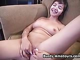 busty amateur Vanessa masturbating on the couch