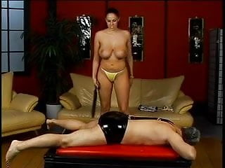 Horny dude gets spanked by hot mistress...