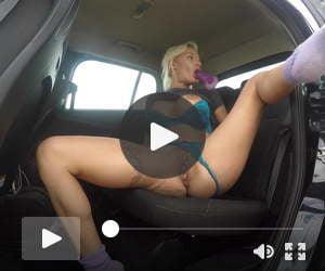 In my car fucking and sucking my dildo