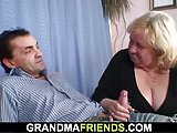 Busty granma in stockings swallows two cocks