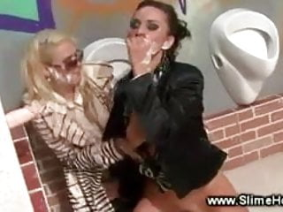 Lesbos getting facial cumshot at the gloryhole