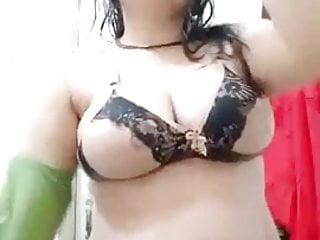 Village girl removes green dress in bathroom