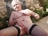 Busty grandma fucks her pussy