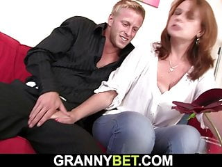 Busty mature gives head and rides his big cock